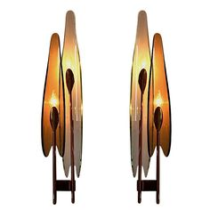 Italy  1950's  Pair of sconces by Max Ingrand for Fontana Arte in brown and clear glass and brass.Model no 1461.