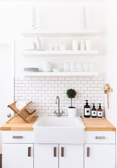 Make the most of a small kitchen with floating shelves, it opens the space up while keeping you organized in style!