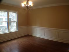 Dining Room with chair rail, shadow boxing, and crown moulding.