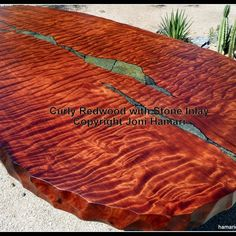 Live edge log furniture - curly red wood table top with stone inlay. I am eager to set up my wood shop and try my hand at making our own live edge furniture for our log home. I love the stone inlay idea. Live Edge Furniture, Resin Furniture, Log Furniture, Wood Slab Table, Log Home Interiors, Live Edge Wood, Looks Cool, Wood Colors, Wood Species