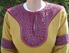 Gorgeous embroidery around the neckline and arm bands of this tunic.