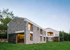 PYO Arquitectos converts stone farmhouse and stable in Spain