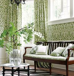 green Thibaut wallpaper and curtains in a light room