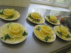 These Lemon Flowers would be lovely on a cold seafood appetizer plate.Lemon Roses for Ladies TeaTop a whole lemon cake in lemon rosesThese Lemon Flowers will be Great to Garnish Your Food. Bridal shower idea for a tea party. Cute Food, Good Food, Lemon Flowers, Fruit Flowers, Edible Flowers, Fruit And Vegetable Carving, Food Carving, Food Garnishes, Garnishing