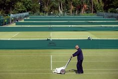 Qualifying - day 1  Preparing the courts - Neil Tingle/AELTC