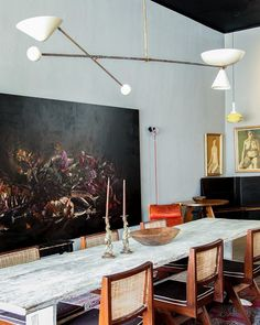 Gorgeous, dramatic modern dining room with large dark oil painting
