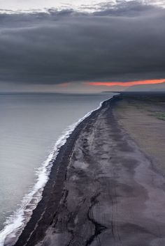 Iceland's volcanic beach at sunset, Iceland / Love Your Mother