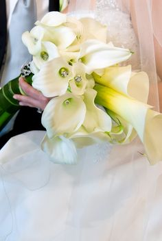 A bouquet of flowers is an accessory to your wedding day fashion...