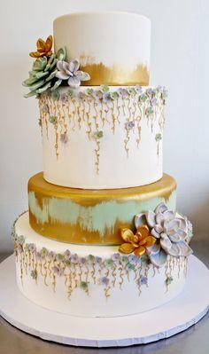 Gold brush, gum paste succulents, gold vines, delicate blossoms, modern midsummer nights dream wedding cake