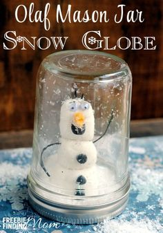 Olaf Mason Jar Snow Globe - Gather the kids for a fun, Frozen inspired craft for kids, an Olaf Mason Jar Snow Globe. Your Olaf Mason Jar Snow Globe will look super cute in either a kid's room, family room or if given as a DIY gift.