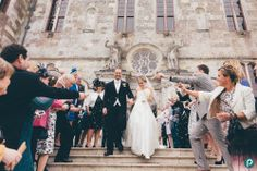 Confetti photo on the steps of Lulworth Castle in Dorset