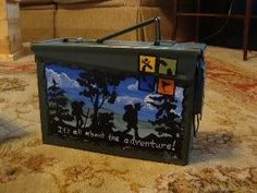 Nicely Painted geocache ammo can.  This would be neat to find.                                                                                                                                                                                 More