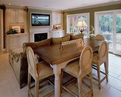 a sitting area between a kitchen and living space, designed by us at bw design group (302.478.8440)