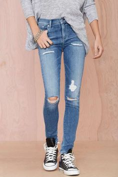 perfectly faded and distressed skinny jeans with Converse sneakers