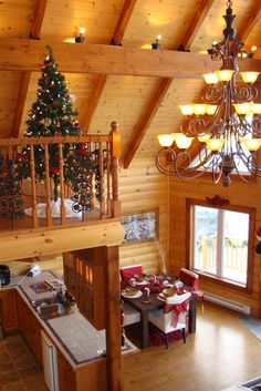 Everyone can agree, a log home is beautiful. A log home at Christmas time is breathtaking! www.timberblock.com