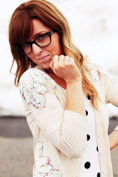 not a fan of her glasses..but love the cardigan and shirt combo!