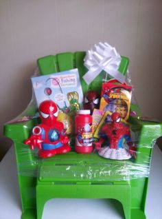 Boys gift basket. Love the idea of using the chair as the basket.