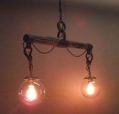 Beautiful hanging light fixture made from an antique horse yoke!