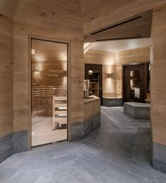 Image 3 of 25 from gallery of Frutt Family Lodge / Philip Loskant Architekt. Photograph by Ulrich Stockhaus Spa Design, Concrete Wood, Concrete Design, Wood Spa, Diy Swimming Pool, Spa Center, Centre, Corridor Design, Mountain Style