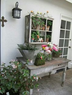 Shabby yet classy porch. Could be a table for serving outdoor dinners or used at a potting table.