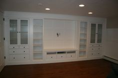 Basement family room with built-in IKEA cabinets