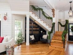 The entryway in the newly remodeled Magnolia House bed and breakfast was opened up by removing walls and a new staircase was created that leads to the second story, as seen on Fixer Upper. (After #3)