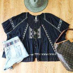 Free People Oversized Embroidered Top Super fun and flowy Free People top with embroidery detail. Perfect to throw over a swimsuit or tank with cutoffs and sandals! Worn a few times. Reasonable offers only, no trades. Bundle 3 items for 20% off ✨ Free People Tops Tunics
