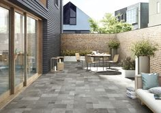 Easy outdoor living decor with Historic tile from Cooperativa Ceramica d'Imola. Outdoor Tiles, Outdoor Spaces, Indoor Outdoor, Outdoor Living, Outdoor Decor, Facade Architecture, Contemporary Architecture, Manufactured Stone, California Homes