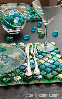 Flimsy fabric placemats are things of the past. Give your tablescape an up-to-the-minute upgrade with brightly colored square glass gems. First, paint a gessoed artist panel with a mixture of silver glitter and découpage medium. Then arrange the gems in a bold chevron pattern (secured with tile adhesive) for an all-grown-up dining experience.