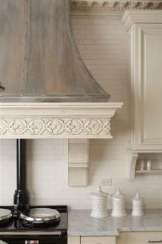 Beautiful range hood. I don't like the way too fancy decotative bottom molding part - I would want that part to be more simple. Another potential option...