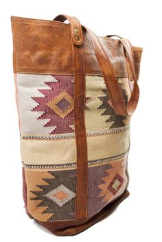 This handcrafted tote by Uxibal is perfect for traveling.