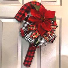 Candy Cane Door Hanger, Holiday Wreaths, Front Door Wreath, Christmas Decor by LiBowDesigns on Etsy Christmas Candy Cane Decorations, Cork Christmas Trees, Candy Cane Crafts, Candy Cane Wreath, Holiday Wreaths, Christmas Crafts, Holiday Decor, Candy Canes, Christmas Ideas