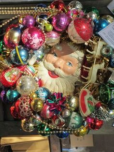 at last- something to do with the old santa box top I couldn't throw away-unless I already threw it away---vintage wreath