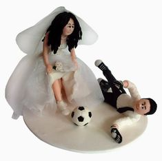 Bride and Groom playing soccer cake topper