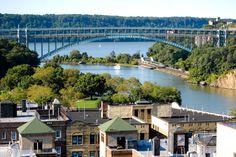 New York City Boroughs ~ Manhattan | Aerial view of Inwood, with Inwood Hill Park on the left, the Harlem River on the right, the Henry Hudson Bridge beyond and New Jersey Palisades on the other side of the Hudson River in the background
