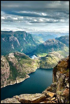 Standing on top of the Preikestolen mountain,Lysefjorden, Norway