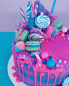 Indulge yourself with this bold and vibrant drip cake! It's bright blue, green and topped with sweeties and sprinkles! There goes some serious sugar intake! Cake Sprinkle Drip Cakes for Every Occasion Pretty Cakes, Cute Cakes, Beautiful Cakes, Amazing Cakes, Candy Birthday Cakes, Bright Birthday Cakes, Candy Theme Cake, Sweet Birthday Cake, Little Girl Birthday Cakes