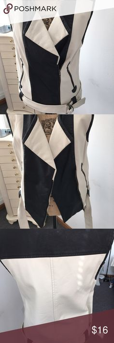Limited faux leather Moto vest Black and cream Moto vest by Forenza for Limited. It buckles at the bottom but can be left worn open as well. Nice material-doesn't feel like vinyl This vest was featured in a magazine--I'm pretty sure Redbook- and sold out. I've worn it once and my coworker tried to take it from me😵 Great condition Size Med and I would recommend no bigger than a 12 Cat friendly home Limited Forenza Jackets & Coats Vests