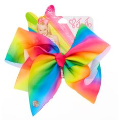 Add some fun color to your hair style with this large rainbow bow from the JoJo Siwa collection. You will really stand out when you attach this funky hair bow to your pony tail making you the envy of all your friends. The bow has been attached to a metal salon clip making it really easy to wear.<UL><LI>JoJo Siwa collection</LI><LI>Large rainbow signature bow</LI><LI>Metal salon Clip<&am...