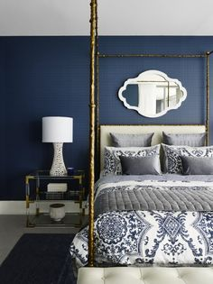 Textured navy wallpaper and gold canopy bed | Greg Natale