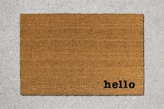 Hello Natural Coir Door Mat   This hand-decorated, one-of-a-kind door mat is the perfect accent to any entryway. Made with resilient and renewable coconut fibers, our doormats effectively whisk away debris from shoes while also also featuring a beautiful design to greet your guests.   MATERIALS AND CRAFTSMANSHIP • Every single door mat is made-to-order and unique • Made with renewable coconut fibers that are both resilient and beautiful • Every mat features a latex, non-skid bottom that…