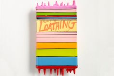 This Artist Dunks Books and Other Objects Into Gloss Paint, With Awesome Results | Mental Floss