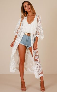 The Grid Kimono In White This classic kimono is so stylish and perfect for the daily grind! Featuring lace detailing, it will add a touch of sophistication and class to every outfit. - Made With Cotton, Polyester & Love- No Lining- Care Fo White Kimono Outfit, White Lace Kimono, Lace Cardigan Outfit, Floral Lace, Kimono Cardigan, Floral Kimono, Bikini Cover Up, Swimsuit Cover Ups, Strand Kimono