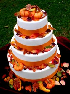 4 tier fall cake with sugar leaves and white chocolate acorns and pumpkins