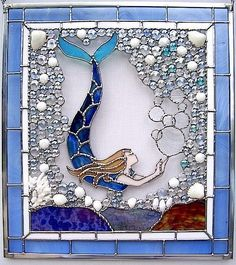 Photo of High Tide Gallery - Saint Augustine, FL, United States. A mermaid stained glass window by John Pacheco, a top-selling artist at High Tide Gallery. His glass fills the front window of the shop. Faux Stained Glass, Stained Glass Designs, Stained Glass Panels, Stained Glass Projects, Fused Glass, Stained Glass Patterns Free, Free Mosaic Patterns, Glass Beads, Glass Painting Designs