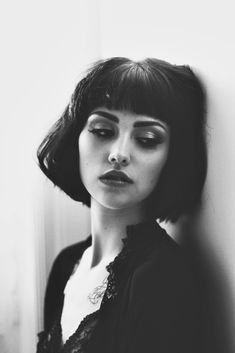 <3 Blunt retro fringe just above eyebrow length with short bob. Low to medium forehead, heart or oval shaped face.