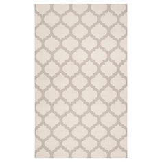 Artfully hand-woven in India, this beautiful wool rug evokes exotic style with a quatrefoil trellis motif.    Product: Rug...