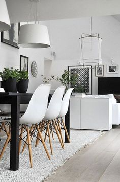 15 Modern Black & White Home Decor Ideas to Copy | Mix in green plants for a pop of color
