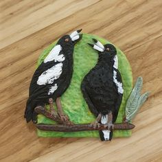 Warbling magpies clay brooch by Lost Daisy Designs 💚💚 ~*~ #handmadejewellery #handcraftedjewellery #handmadebrooch #claybrooch #polymerjewellery #unqiquegiftideas #uniquegifts #magpies #australianmagpie #australianatives #nativebirds #creatorslane #makersmovement #handmadeau #handmademovement #handmadeisbetter #makersgonnamake Brooches Handmade, Handmade Jewellery, Handcrafted Jewelry, Handmade Items, Unique Jewelry, Aussie Christmas, Christmas Crafts, Christmas Ornaments, Magpie