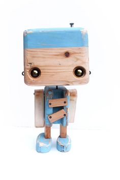 Raw recycled wood  the bicolor light blue robot